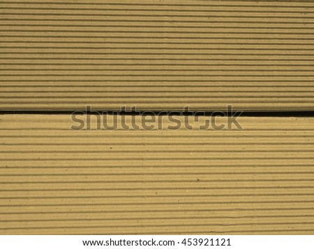 Brown corrugated cardboard useful as a background vintage sepia