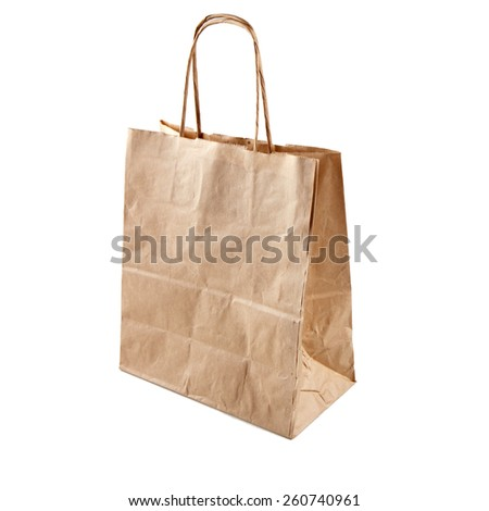 Brown craft  paper bag isolated on a white background. Used recycle paper  bag. - stock photo