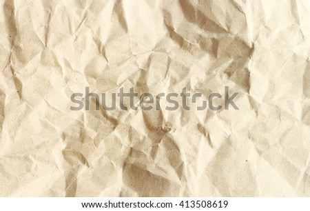 Brown crumpled paper texture. - stock photo