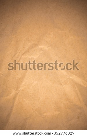 Brown crumpled recycle paper background.