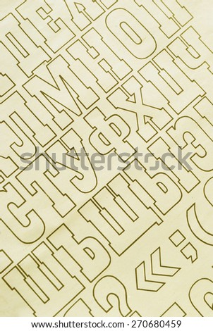 brown cyrillic alphabet letters printed on white paper