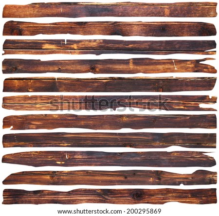 brown damaged planks pieces isolated over white background - stock photo