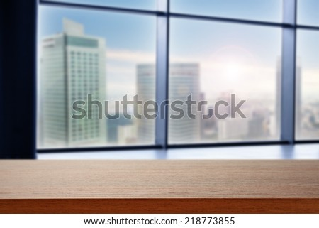 brown desk and city  - stock photo