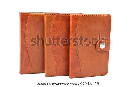 brown diaries on a white background