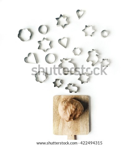 Brown dough for cookies on cutting dough isolated on white background, flat lay, overhead view - stock photo