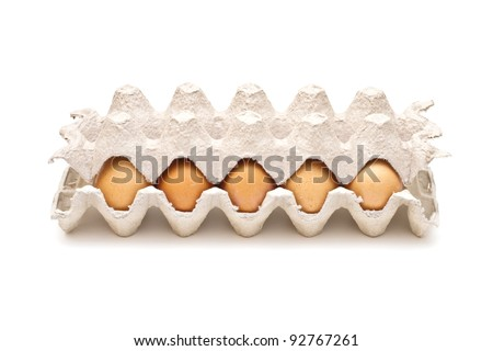 Brown eggs in a carton package on white background - stock photo