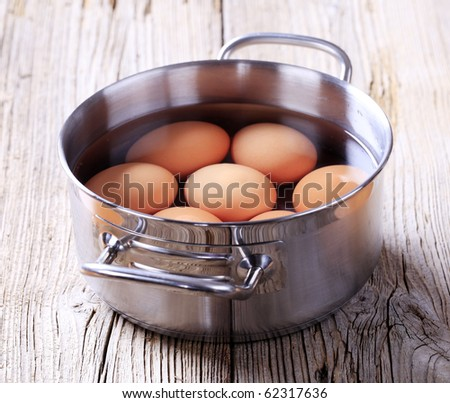 Brown eggs in a pan - stock photo