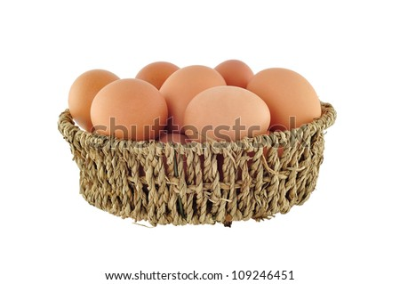 brown eggs in basket isolated on white background