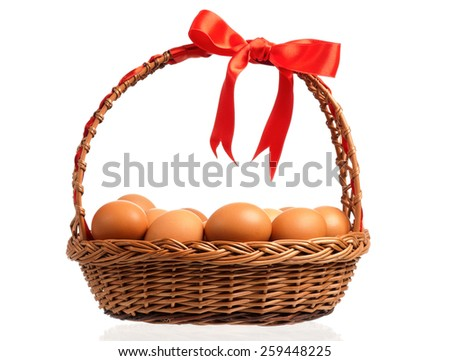 Brown eggs in the basket, isolated on a white background