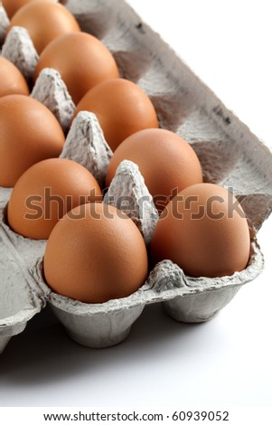 Brown eggs inside an egg carton - stock photo