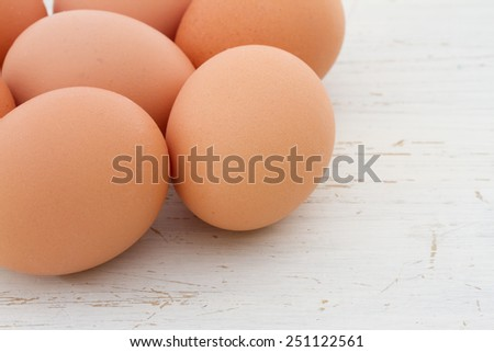 Brown eggs on a white shabby table - stock photo