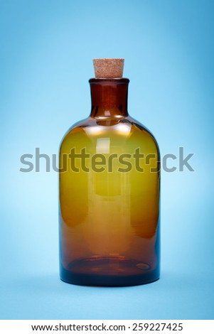 Brown empty laboratory glass chemical bottle shut with cork stopper - stock photo