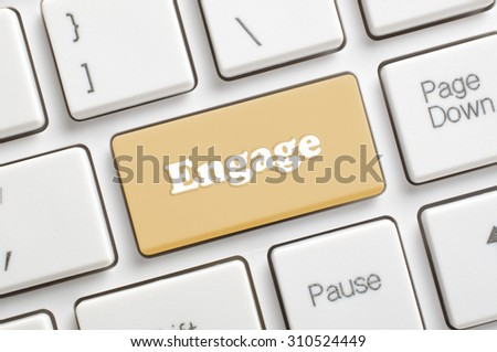 Brown engage key on keyboard - stock photo