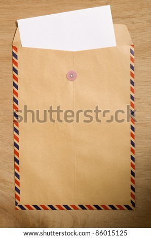 Brown envelope and paper. You can put your text on the paper - stock photo