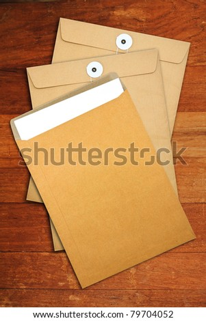 Brown Envelope document  on a wooden desk - stock photo