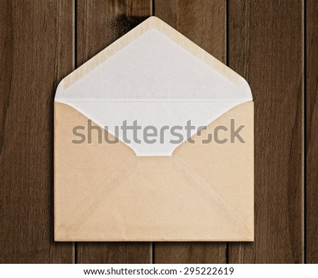 Brown Envelope  on wood background, clipping path.