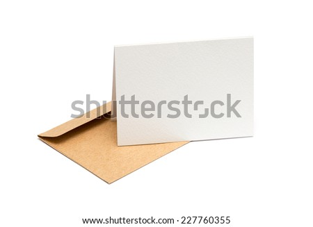 brown envelope with a blank white card over white - stock photo