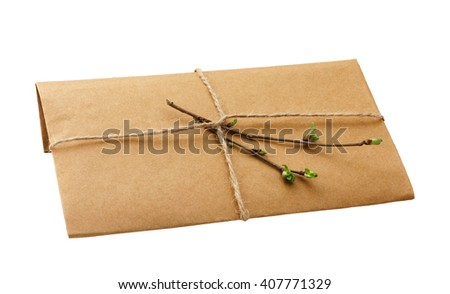 brown envelope with a young sprig of cherry isolated on white background