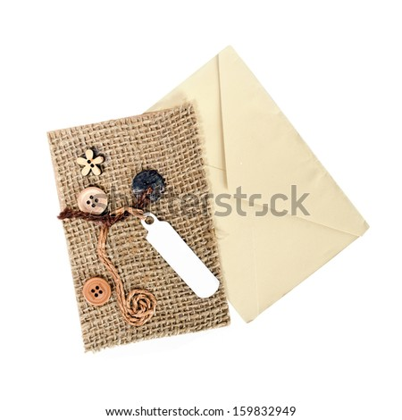 brown envelope with card  isolated on white background - stock photo