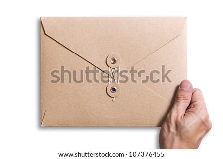 brown envelope with hand holding it - stock photo