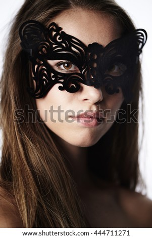 Brown eyes masked beauty in close up - stock photo