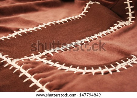 Brown fabric as a background.