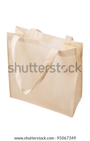 Brown fabric bag on white isolated background. - stock photo
