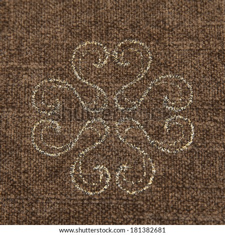 Brown fabric with a floral ornament