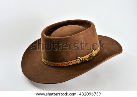 Brown felt hat on white background.Cowboy hat.Vintage American western style hat. - stock photo
