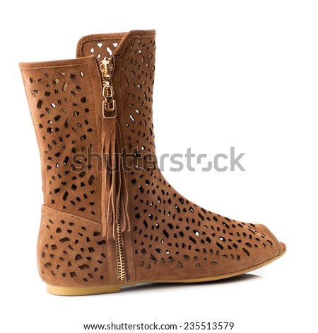 Brown female boot isolated on white background. - stock photo