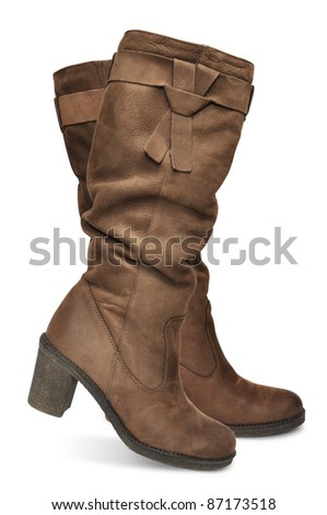 brown female boots isolated on white background - stock photo