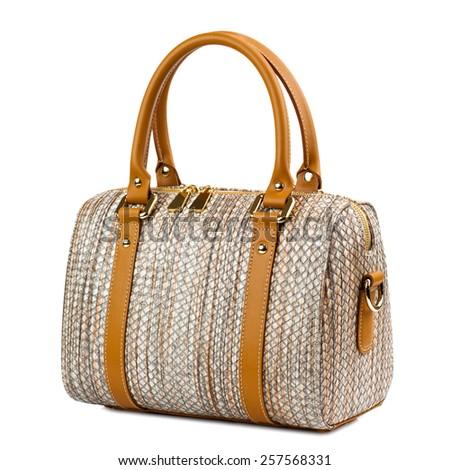 Brown female leather handbag isolated on white background - stock photo