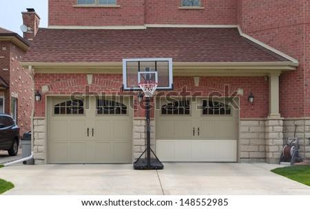 brown fiberglass garage doors - stock photo