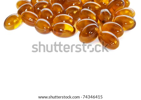 brown fish oil gel capsule pills closeup isolated on white background - stock photo