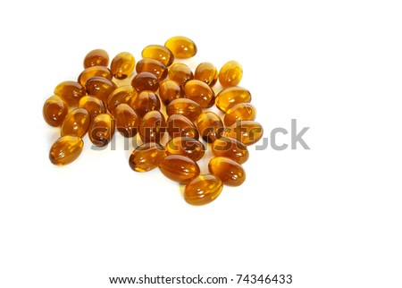 brown fish oil gel capsule pills closeup isolated on white background