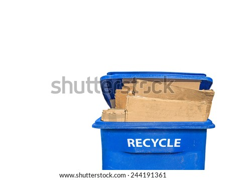 "Brown flattened corrugated boxes in blue plastic recycling bin, front view. Open lid. White letters of the word ""RECYCLE"" on side of container.Isolated on a white background.Room for text.Copy space.  - stock photo"