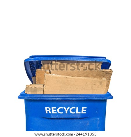 "Brown flattened corrugated boxes in blue plastic recycling bin, front view, vertical composition. Open lid.White letters of the word ""RECYCLE"" on side of container. Copy space. Isolated on white.  - stock photo"