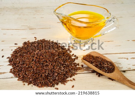 brown flax seed and linseed oil - stock photo