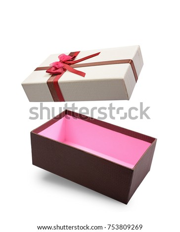 Brown flying open gift box with multicolored satin bow isolated on white background