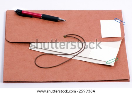 Brown folder with important confidential papers with pictures - stock photo