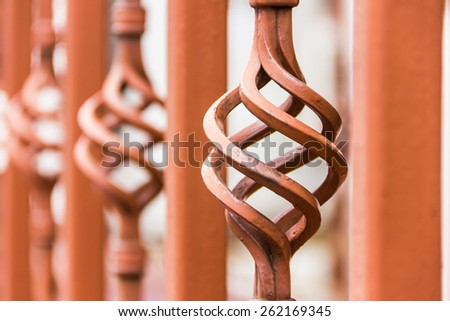 Brown forged fence inserts close-up - stock photo