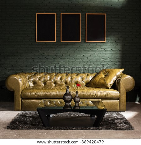 Brown furniture and concrete wall with spot lighting,selective focus on sofa. - stock photo