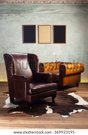 Brown furniture and concrete wall with spot lighting,shallow Depth of Field,Focus on brown sofa. - stock photo