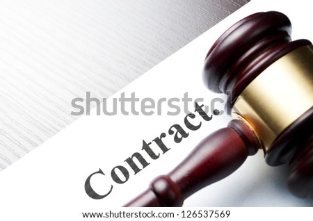 brown gavel on the table and shot with shallow depth of field - stock photo