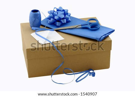 Brown gift box with wrapping materials - stock photo