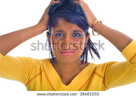 Brown girl being stressed - pulling her hair out - stock photo