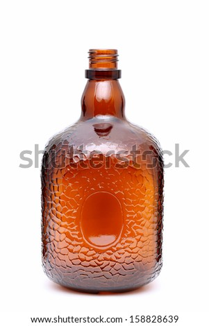 Brown glass bottle isolated on white background - stock photo