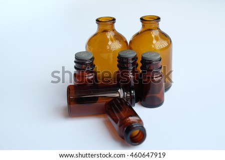 Brown glass bottles on white background