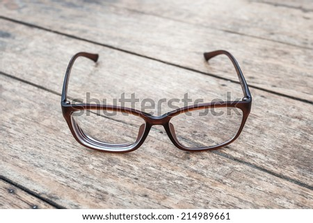 Brown glasses on wood table