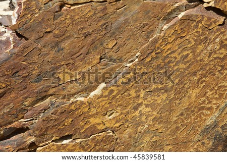 Brown Granite Background with grooves and cracks - stock photo